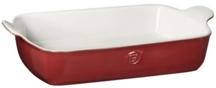 A rectangular baking dish with a red glaze and white interior.