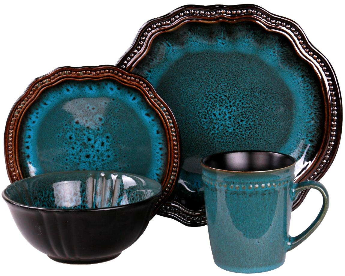 Dark and teal plates, a bowl and a mug with wavy edges.