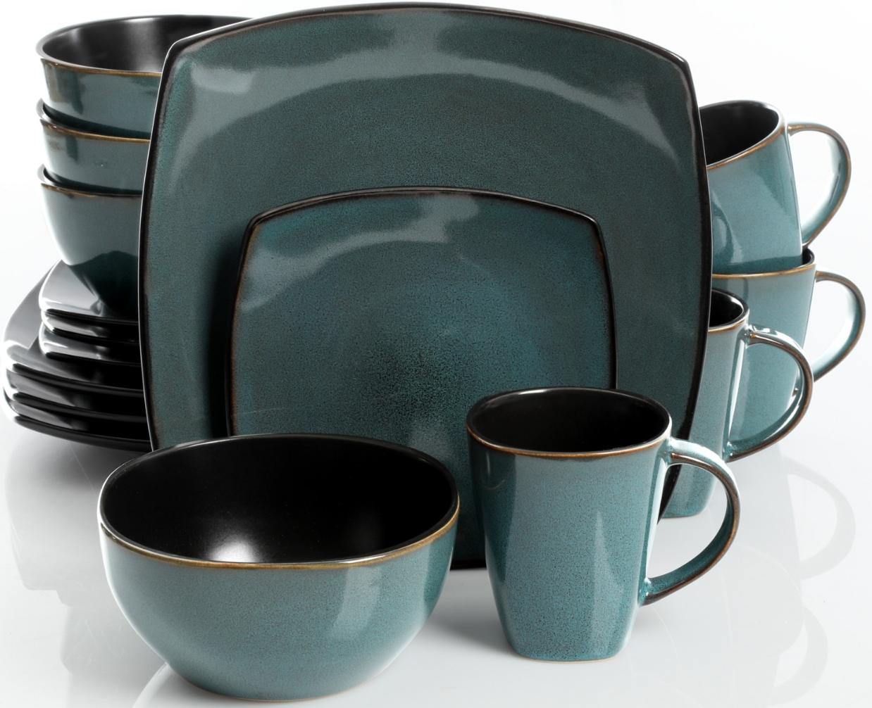 A teal dinnerware set with dinner plates, dessert plates, bowls and mugs.