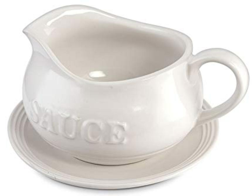 A white gravy boat with the word sauce on the side.