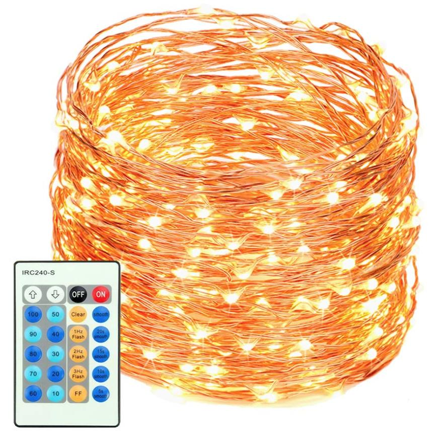 A coil of golden string lights with a remote control.