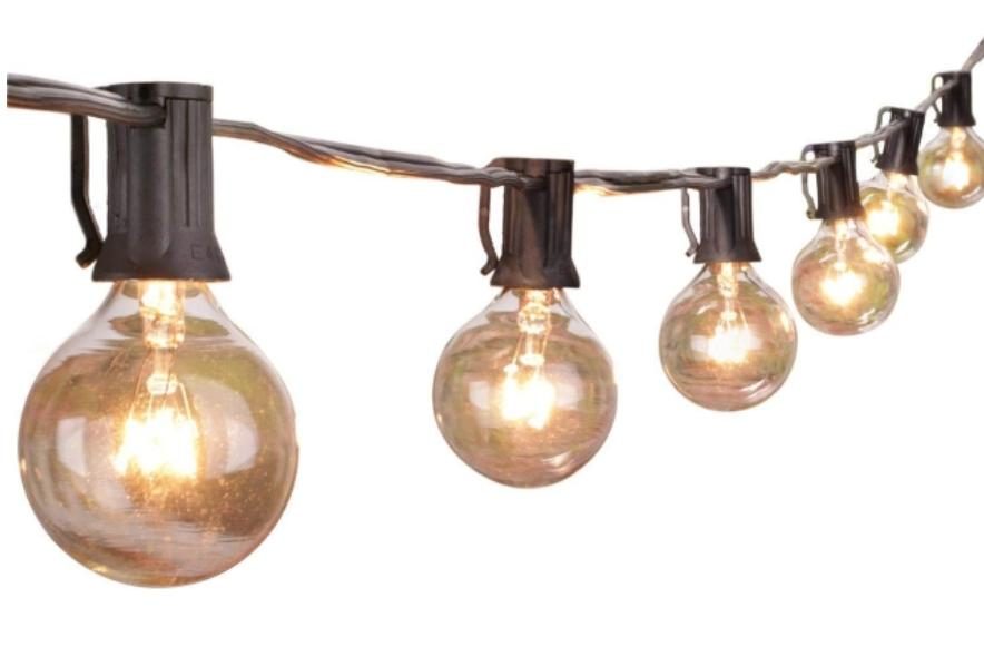 A string of bulb lights lit up in gold.