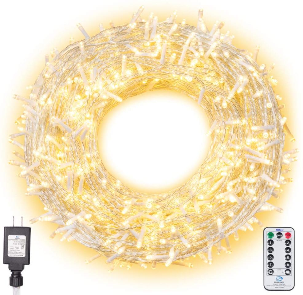 A coil of fold lights with a remote control down and to the side.