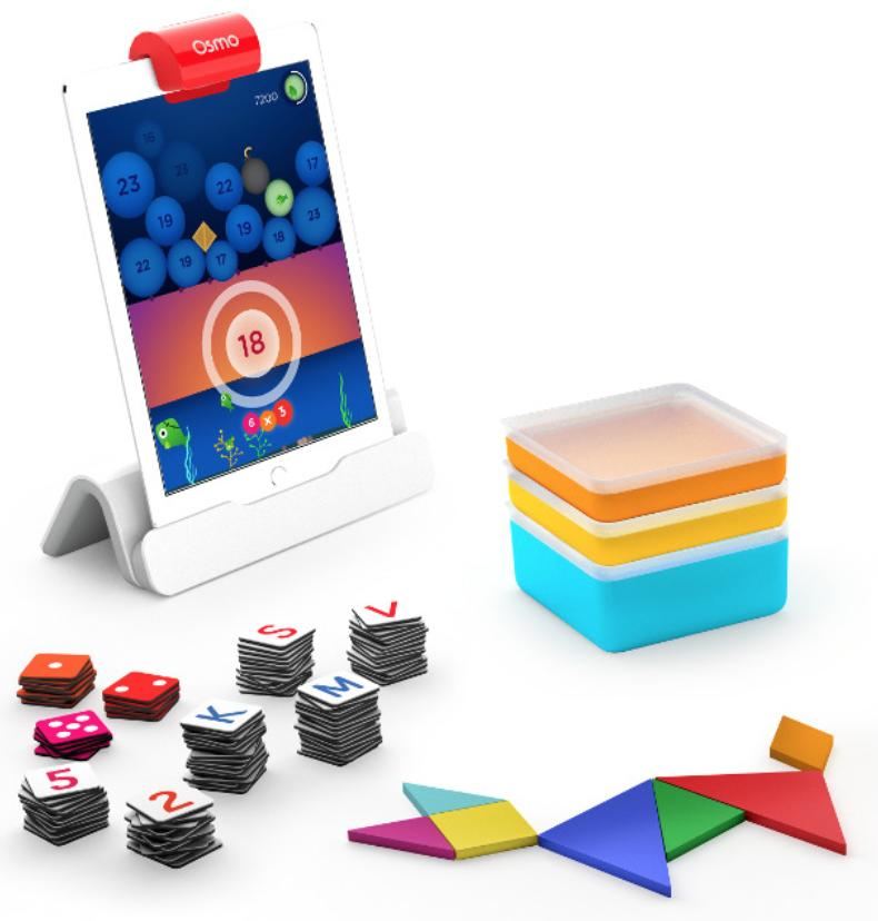Toys are arranged in front of the Osmo app open on a tablet.