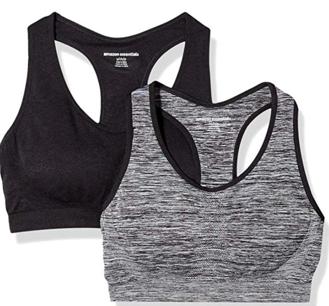A pair of grey and black racerback sports bras.