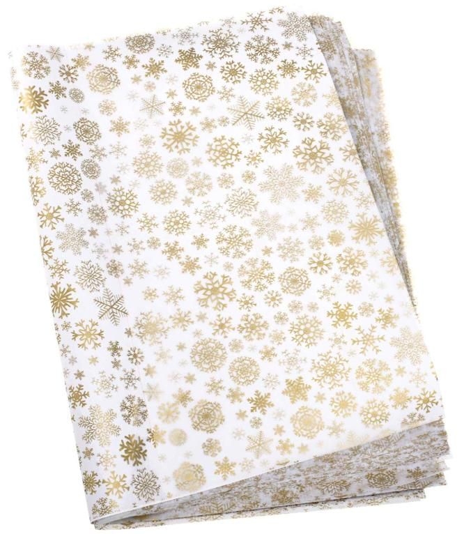 White tissue paper with gold snowflakes.