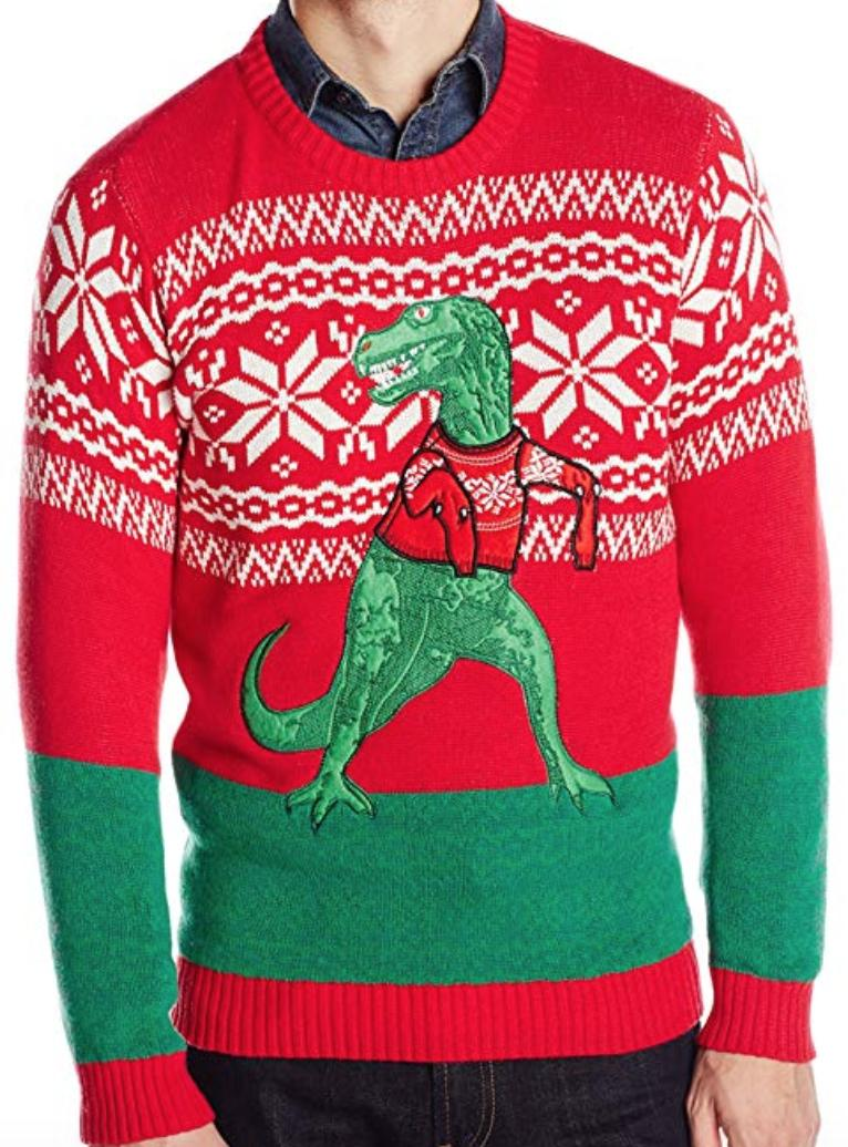 A T-rex wearing a sweater is on a sweater decorated in red and green.