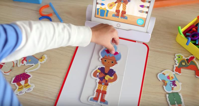 Children play the Osmo Little Genius dress up game.
