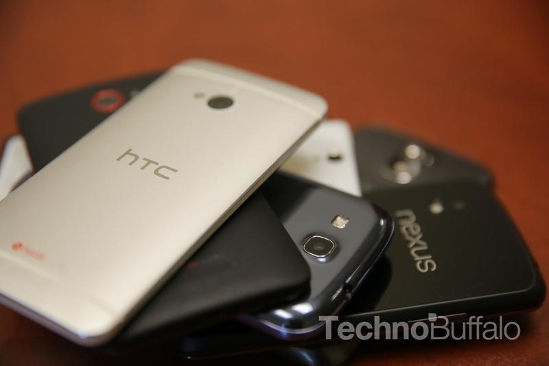 HTC One in White - Rear Camera on Top of a Stack of Phones