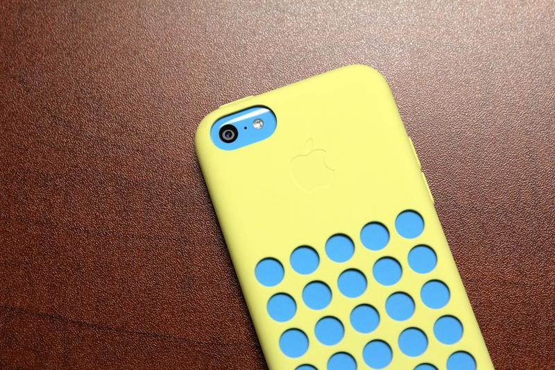 iPhone 5C in Blue with yellow case camera closeup