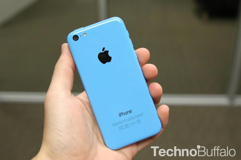 iPhone 5c in Blue in hand.