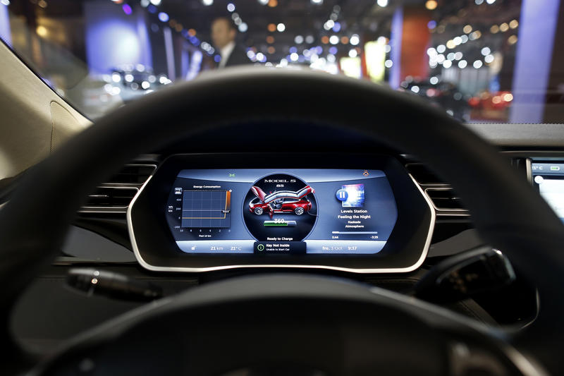 The driver's electronic dashboard sits illuminated inside a Tesla Model S automobile, produced by Tesla Motors Inc., at the Paris Motor Show on the final preview day in Paris, France, on Friday, Oct. 3, 2014. The show, also known as Mondial de L'Automobile, runs from Oct. 4 through Oct. 19 and showcases 250 automobile manufacturers from 18 countries. Photographer: Simon Dawson/Bloomberg
