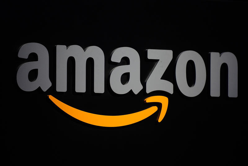 The Amazon logo is seen on a podium during a press conference in New York, September 28, 2011. Amazon CEO Jeff Bezos introduced a line of four new Kindle products, the Kindle Fire tablet, the Kindle Touch 3G, the Kindle Touch and a new lighter and smaller Kindle. AFP PHOTO/Emmanuel Dunand (Photo credit should read EMMANUEL DUNAND/AFP/Getty Images)