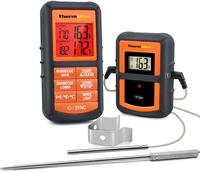 A Thermopro meat thermometer in black and orange with probes on a white background.