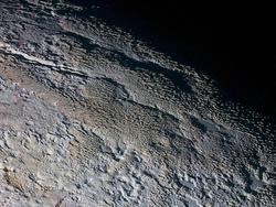"Gorgeous images reveal Pluto's ""snakeskin"" surface"