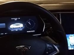 Tesla Model S hacked to play movies