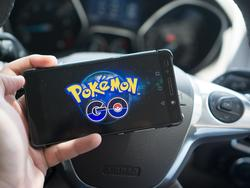 Pokémon GO player hits a police car while driving, caught on camera