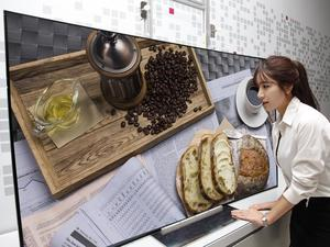 LG Unveils New Ultra HD Curved TVs, One Flexes at the Touch of a Button