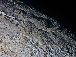 """Gorgeous images reveal Pluto's """"snakeskin"""" surface"""