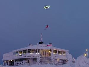 Watch this drone carry a human while he snowboards