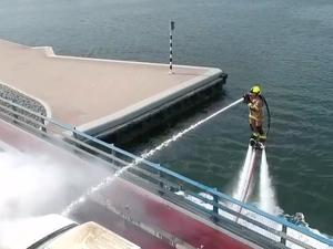Dubai firefighters use jetpacks to extinguish car accidents on bridges