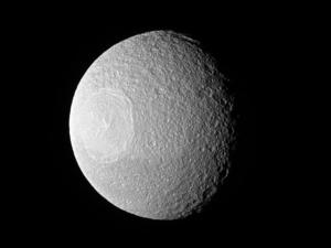 Cassini captures close up images of Saturn's moon Tethys and its enormous crater