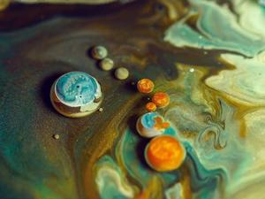 Enjoy the galactic beauty of mixing paint and oil